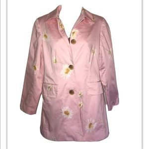 Pink coat with daisy print.